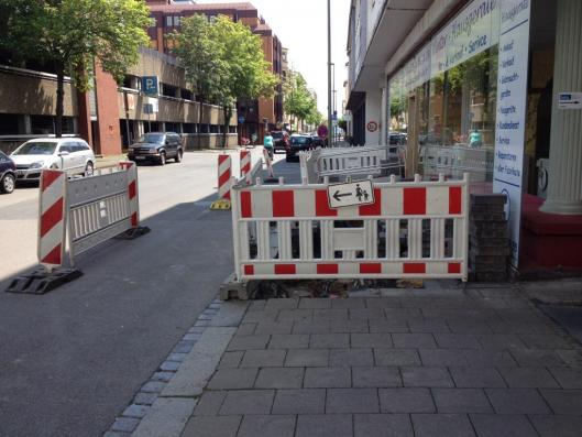 Here's a German example of how a sidewalk-area can be maintained during construction. Portland's new rules recommend a similar approach. Photo: Bernard Finucane